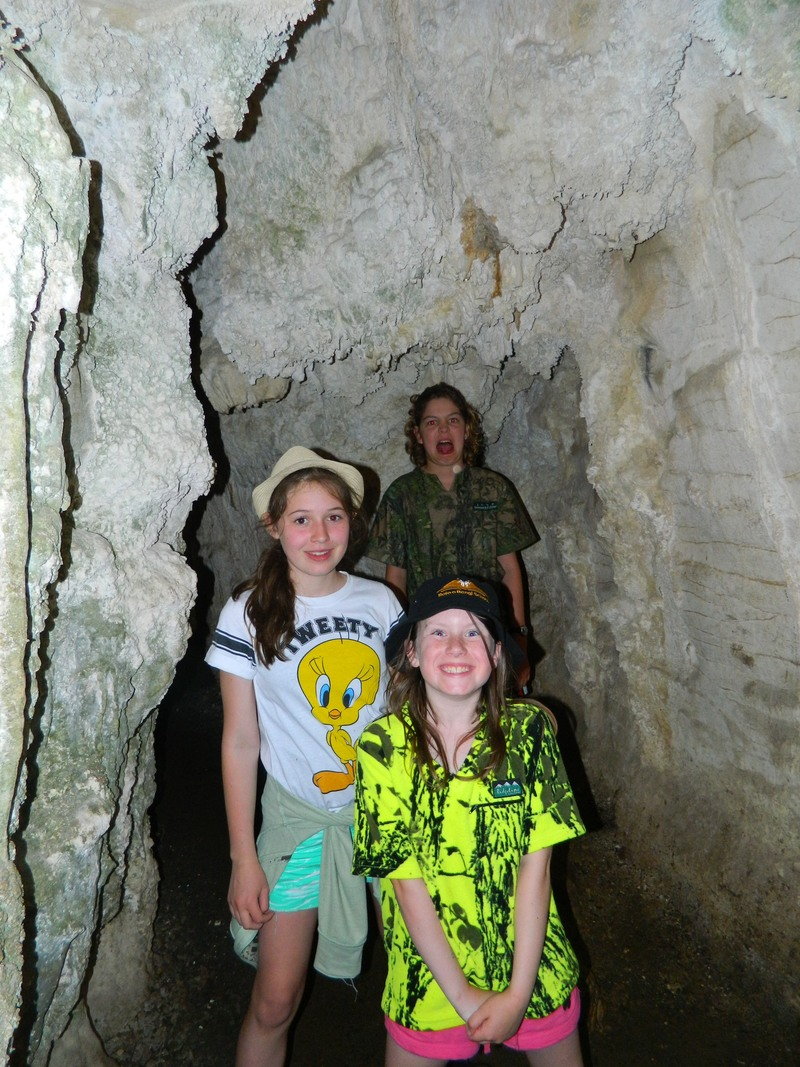 Madison, Kyla and Harrison in a cave.