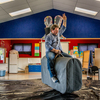 Roto O Rangi School Principal Wayne Donnellon Has A Go On Marco The Mechanical Bull. Photo By Michael Jeans.