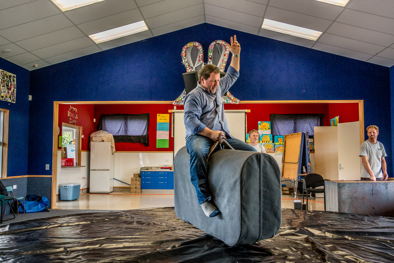 Roto O Rangi School Principal Wayne Donnellon Has A Go On Marco The Mechanical Bull. Photo By Michael Jeans.