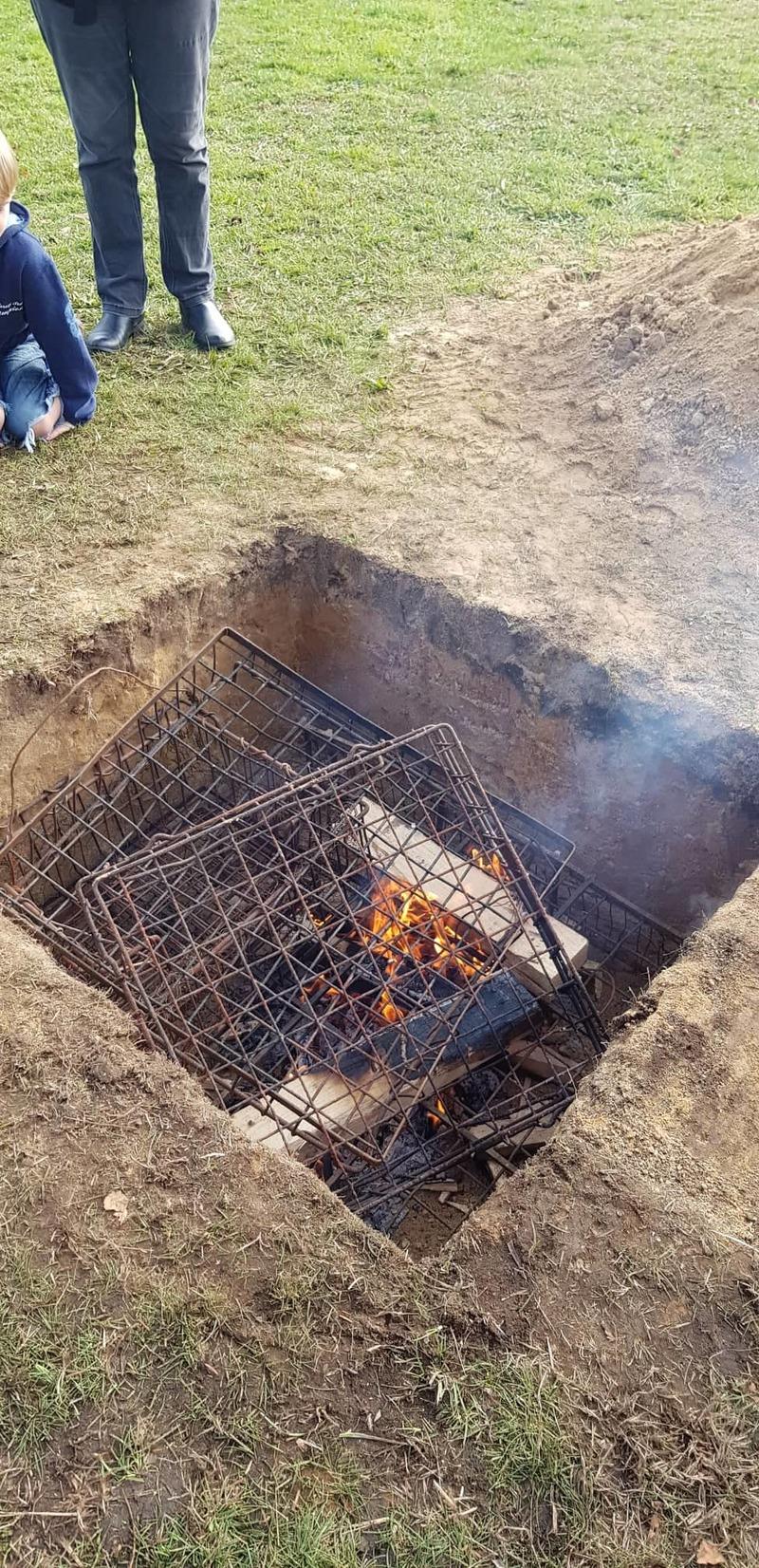 Preparing The Hangi Fire11