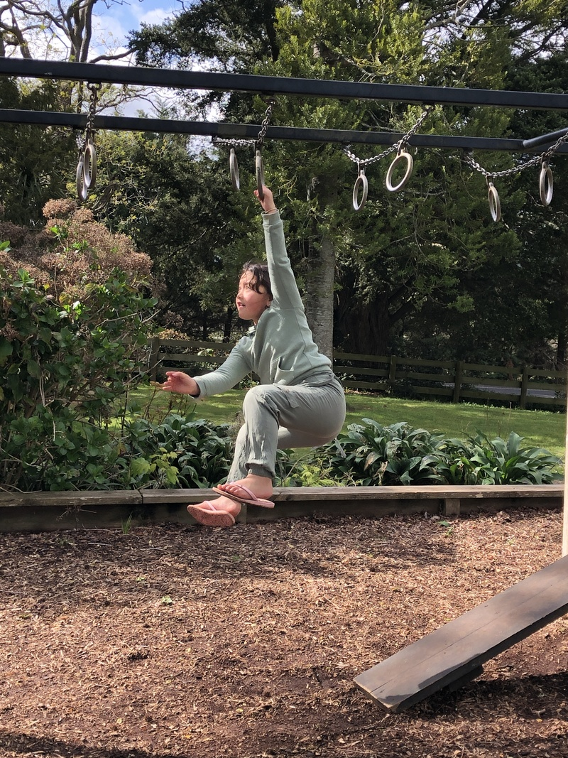 Charlize one-handed on the bars
