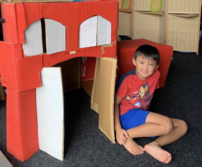 A big red house made from a cardboard box