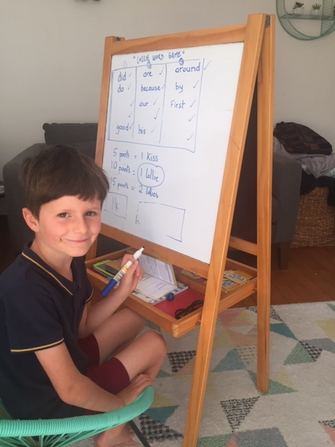 Victor practising his writing