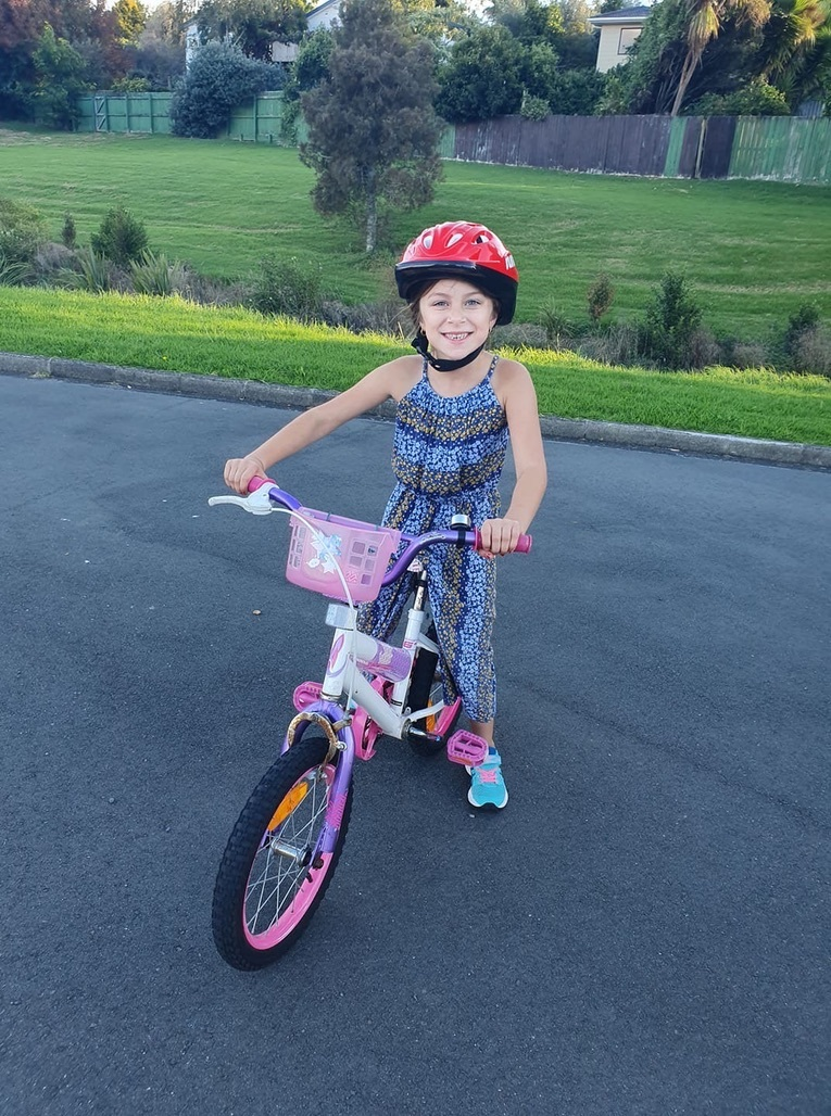 Zahra riding without training wheels!
