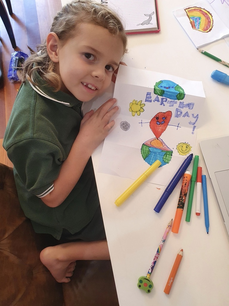 Marilla completing her pop up earth day card