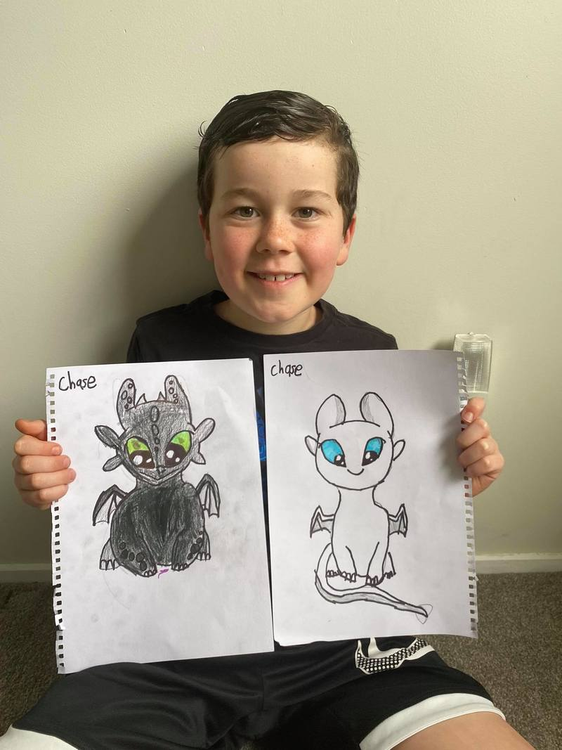 Chase with drawings of his favourite characters from How to Train Your Dragon